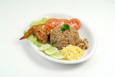 goreng: fried rice serve with chicken wing - malaysian food