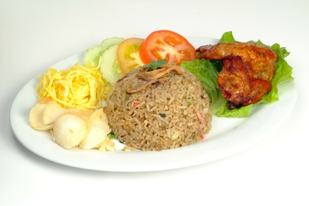 fried rice serve with chicken wing - malaysian food Stock Photo - 10118875