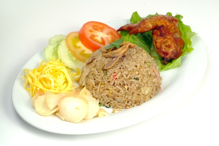 fried rice serve with chicken wing - malaysian food  Stock Photo - 10195391