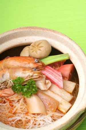 claypot seafood serve with rice noodle  photo