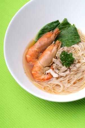 Shrimp serve with rice noodle soup photo
