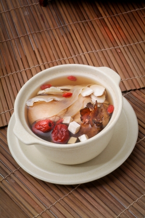 meat soup: Chicken and herb soup in pot, Chinese food style