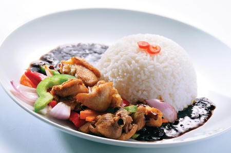 Chicken with rice and vegetables in background Stock Photo - 13202594