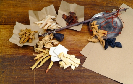 Chinese herbal medicine on wood background photo
