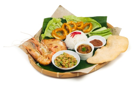 Indonesian traditional food, chicken, fish, vegetables photo
