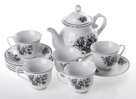 antique dishes: tea pot set, Porcelain tea pot and cup on white background Stock Photo