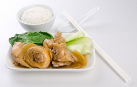 Chicken with rice and vegetables in background photo