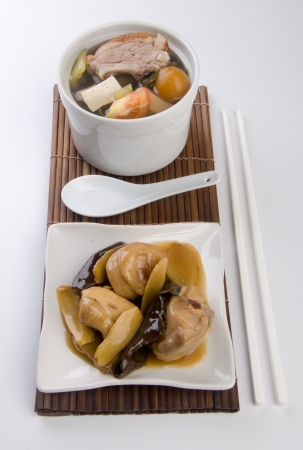 Chicken and herb soup in pot, Chinese food style. photo