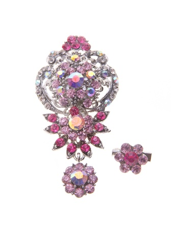 brooch with different gems on a background  photo