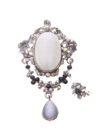 diamond necklace: brooch with different gems on a background