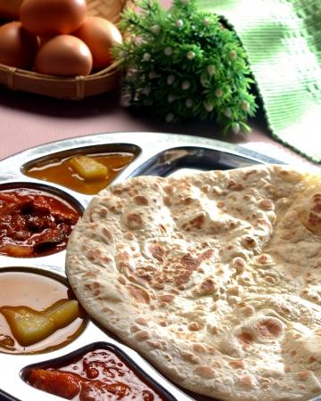 carbohydrates food: Roti canai, roti tisu, traditional south indian fried bread Stock Photo