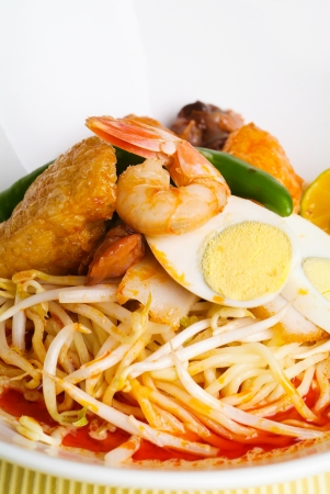 laksa: Curry Laksa which is a popular traditional spicy noodle soup from the Peranakan culture in Malaysia and Singapore