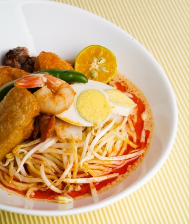 Curry Laksa which is a popular traditional spicy noodle soup from the Peranakan culture in Malaysia and Singapore photo