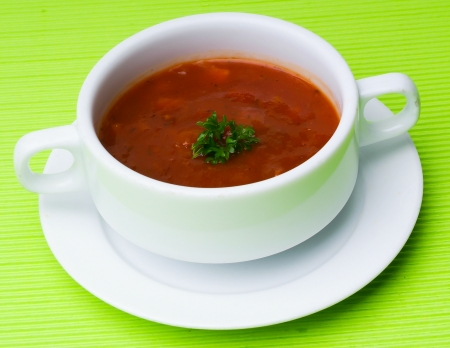 tomato soup. tomato soup on background photo