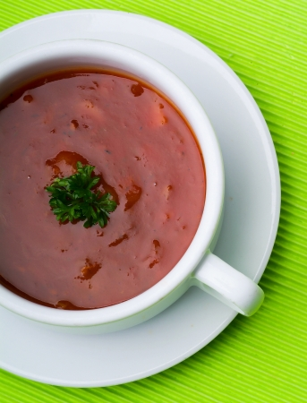 tomato soup. tomato soup on background photo