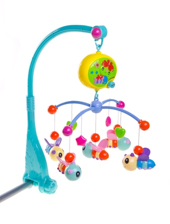 Hanging toy attached to a baby cot. Toys are officially property released.