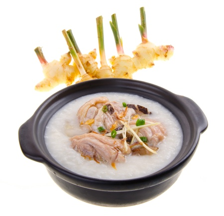 china cuisine: chicken Porridge (congee) served in claypot Stock Photo