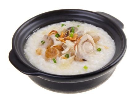 abalone chicken Porridge (congee) served in claypot Stock Photo