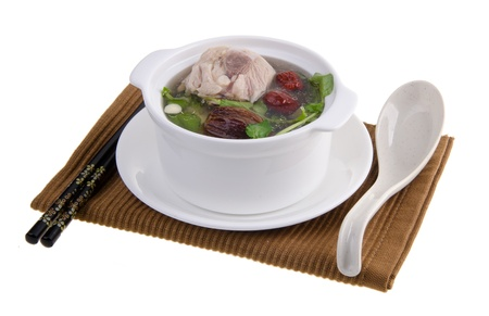Chicken and herb soup in pot, Chinese food style.