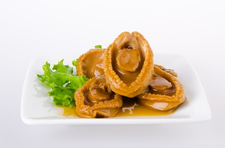 Abalones  Chinese cuisine abalone on the background  photo