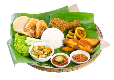 Indonesian traditional food, chicken, fish, vegetables Stock Photo - 16256235