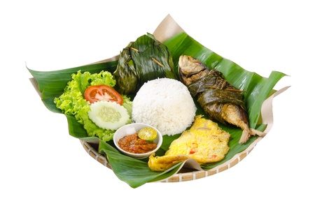 banana leaf: Indonesian special fish dish, Ikan, on the background Stock Photo
