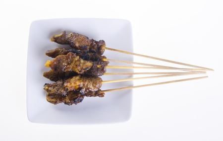 Satay. Asian cuisine - Satay on a background photo
