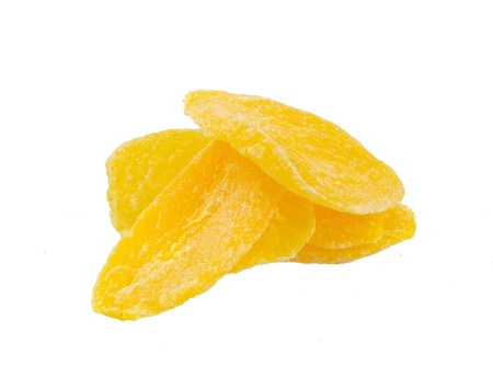 dried plums: Dried Mango slices on the background Stock Photo