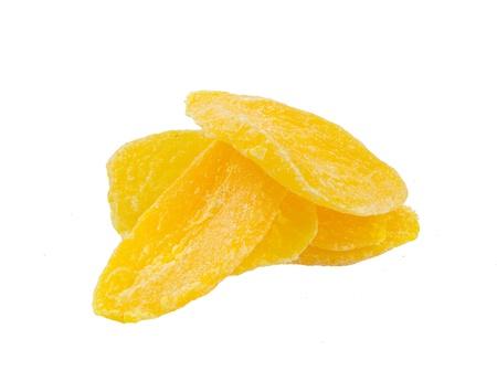 legumbres secas: Secas rebanadas de mango en el fondo Foto de archivo