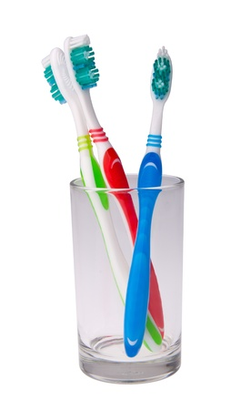 bristle: toothbrushes in a glass on background. Stock Photo