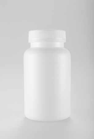 and vitamin: White medicine bottle on white background