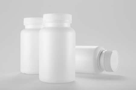 White medicine bottle on white background photo