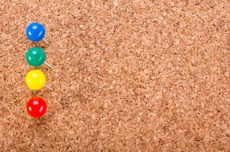 corkboard: push pin pinned on corkboard