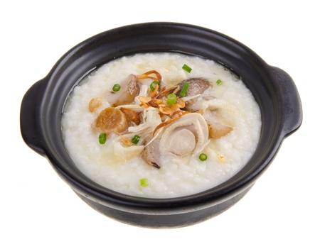 Porridge, abalone & chicken Porridge (congee) served in claypot