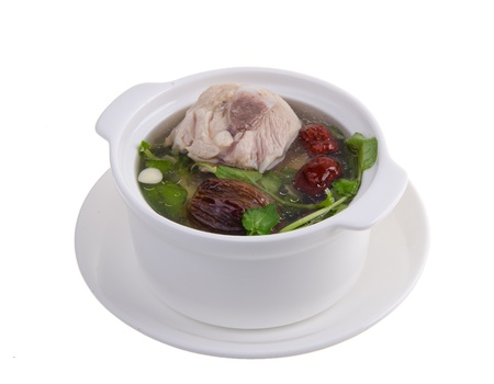 Chicken and herb soup in pot, Chinese food style  photo
