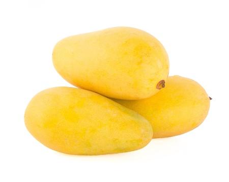 mango. yellow mango on the background
