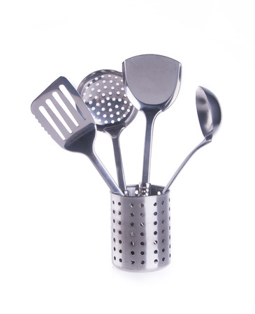 kitchen utensils. kitchen utensilson on background photo