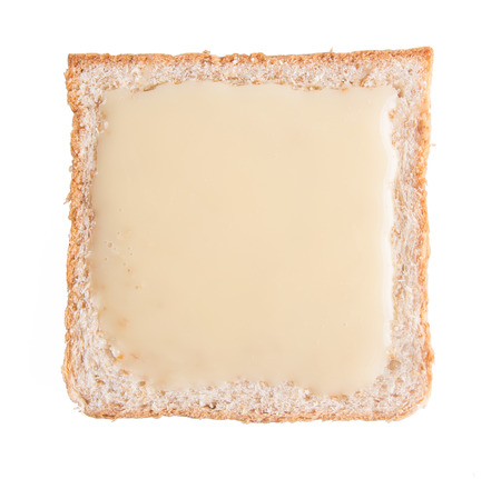 bread. bread with condensed milk on background photo