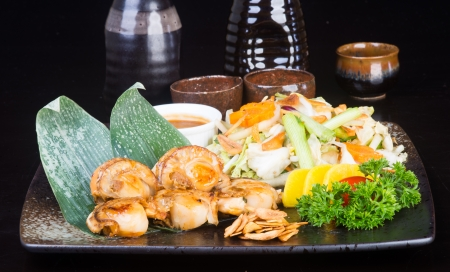 stuffed fish: japanese cuisine. grilled shell fish on background