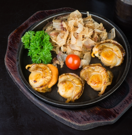 stuffed fish: japanese cuisine grilled shell fish on background