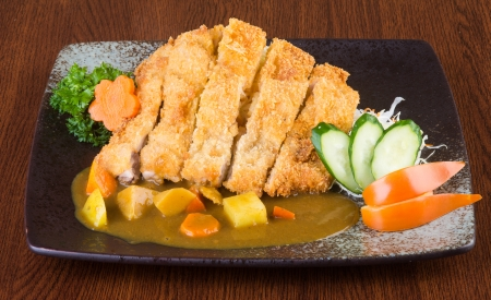 japanese cuisine fried chicken curry on the background