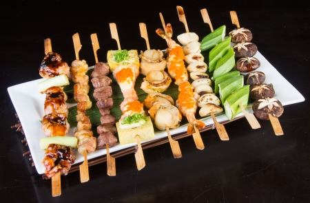japanese cuisine grill sticks on background photo