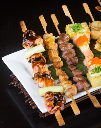 japanese cuisine grill sticks on background photo
