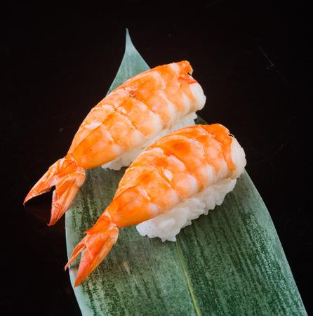 japanese cuisine. sushi shrimp on background photo