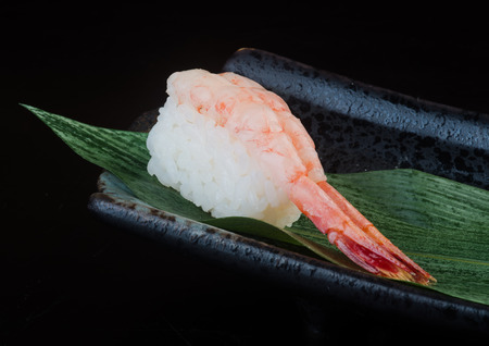 japanese cuisine. sushi shrimp on background photo