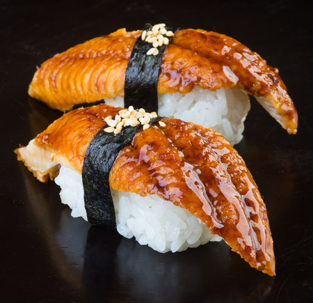 japanese cuisine. sushi unagi on background photo