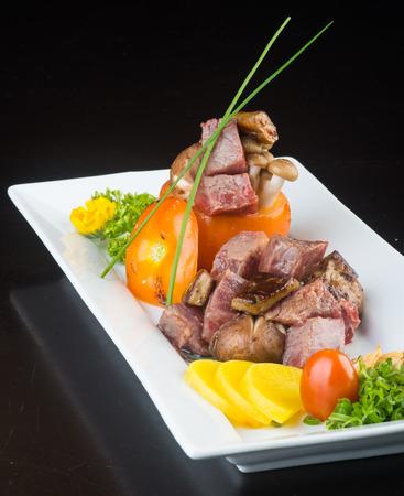 japanese cuisine. beef cube on background photo