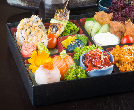 japanese cuisine. lunch box set on the background photo