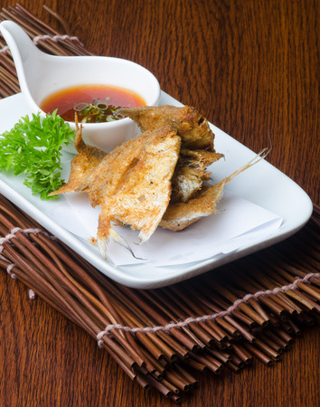 japanese cuisine. fried fish on background photo