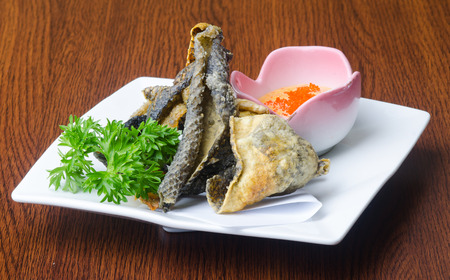 japanese cuisine. fried fish skin on background photo